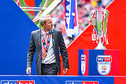 Lee Bowyer of Charlton Athletic (Manager) looks at the play off trophy and placing it down during the EFL Sky Bet League 1 play off final match between Charlton Athletic and Sunderland at Wembley Stadium, London, England on 26 May 2019.