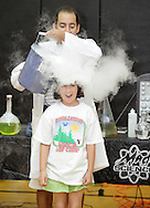 Middletown, New York - Erik Maldonado, rear, pours a stream of carbon dioxide gas from a bucket full of water and dry ice on a camper during a Mad Science demonstration at Middletown YMCA summer camp on Aug. 20, 2010.