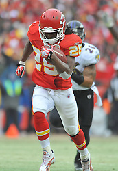 Jan 09, 2011; Kansas City, MO, USA; Kansas City Chiefs running back Jamaal Charles (25) runs in for a touchdown as Baltimore Ravens safety Dawan Landry (26) attempts to tackle during the 2011 AFC wild card playoff game at Arrowhead Stadium. Mandatory Credit: Your Name-US PRESSWIRE