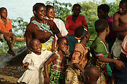 Africa. Malawi. Rural village on the Lake Shore..Traditional dance taking place under a mango tree. Men play drums and women dance. .CD0010