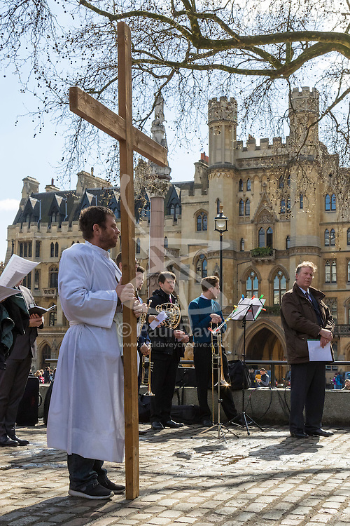 Westminster, London, March 25th 2016. Westminster's annual interdenominational Easter procession takes place with a procession from Methodist Central Hall to Westminster Cathedral and then on to Westminster Abbey, with the cross borne by people from The Passage, a homeless charity. PICTURED: A cross bearer from homeless charity The Passage stands silently waiting for the procession to begin. <br /> ©Paul Davey<br /> FOR LICENCING CONTACT: Paul Davey +44 (0) 7966 016 296 paul@pauldaveycreative.co.uk