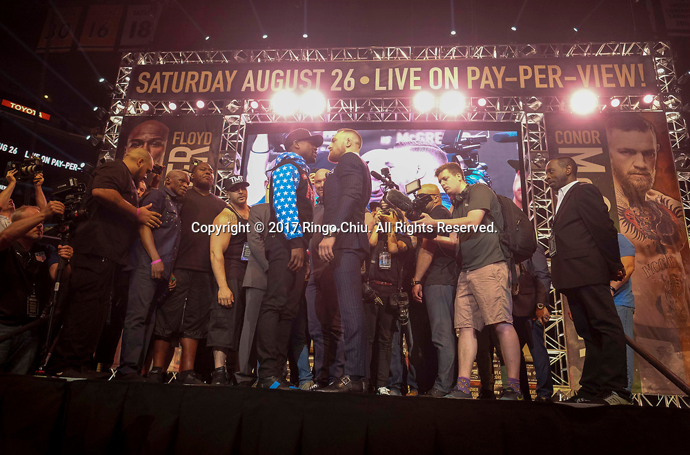 Floyd Mayweather Jr. and Conor McGregor in the LA Press Tour news conference at Staples Center Tuesday, July 11, 2017, in Los Angeles. The two will fight in a boxing match in Las Vegas on August. 26.<br /> (Photo by Ringo Chiu)<br /> <br /> Usage Notes: This content is intended for editorial use only. For other uses, additional clearances may be required.