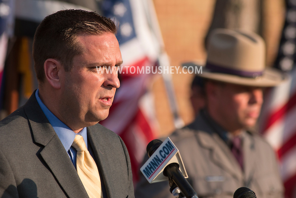 Goshen, New York - Orange County Executive Steve Neuhaus speaks during the Orange County Law Enforcement Officer Memorial Service on May 8, 2015, at the entrance of the Orange County Courthouse. The memorial service honors the memory of the members of the Orange County law enforcement community that died in the line of duty. The service also pays tribute the families and loved ones left behind for their courage, dignity and perseverance.