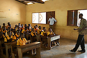 Calvin Doe, Youth Ambassador, at a reading club in Mbaem community school. The club has been set up as part of the Kraft Cocoa Partnership, to educate and inspire the younger generation about the potential of cocoa farming.