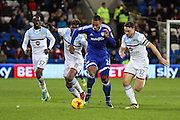 Kenneth Zohore of Cardiff City powers past James Chester and Aaron Tshibola of Aston Villa during the EFL Sky Bet Championship match between Cardiff City and Aston Villa at the Cardiff City Stadium, Cardiff, Wales on 2 January 2017. Photo by Andrew Lewis.