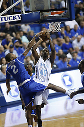 Kentucky Alum Aaron Harrison, left, contests a shot by North Carolina Alum Harrison Barnes in the first half. The Kentucky Alumni Men's Basketball team hosted the University of North Carolina Alumni in a charity game, Sunday, Sept. 13, 2015 at Rupp Arena in Lexington. <br /> <br /> Photo by Jonathan Palmer