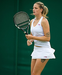 LONDON, ENGLAND - Monday, June 25, 2012: Karolina Pliskova (CZE) with tattoos on her left arm and leg during the Ladies' Singles 1st Round on the opening day of the Wimbledon Lawn Tennis Championships at the All England Lawn Tennis and Croquet Club. (Pic by David Rawcliffe/Propaganda)