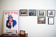 "Washington, D.C. - January 23, 2015: Chris Wallace, is the Anchor of Fox News Sunday. On his office wall he has a WW II poster given to him by Donald Rumsfeld and photos of all the presidents he's interviewed, except Ronald Reagan. After the 9/11 attacks Chris Wallace attended an event with Donald Rumsfeld, where the then Secretary of Defense handed out WW II era posters to attendees. Chris Wallace said,""After 9/11 I attended an off-camera briefing that Donald Rumsfeld, Secretary of Defense at the time, gave to a number of reporters on the War on Terror. He took us into his office afterward and showed us several mementos from his career, including these posters. They had a World War II look about them, and we were all intrigued. He handed them out and I was thrilled to have one.""<br /> <br /> ""Over the course of my career in newspaper and television, I've had some remarkable experiences and it's fun to have photos of them around. I have a wall devoted to photos of presidents I interviewed, except for Reagan. I have everyone following him, along with Vladimir Putin when he was president of Russia in 2006. Probably the most interesting is the 2006 photo of my interview with former president Bill Clinton. I asked him what I thought was a fairly innocuous a question but he gave me a tongue lashing for about 20 minutes. ""<br /> <br /> The objects in Wallace's office in the Fox News D.C. Bureau is a mix of personal, political and celebrity history. <br /> <br /> CREDIT: Matt Roth for The New York Times<br /> Assignment ID: 30169659A"