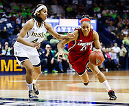 SOUTH BEND, IN - FEBRUARY 11: Skylar Diggins #4 of the Notre Dame Fighting Irish guards as Bria Smith #21 of the Louisville Cardinals dribbles the ball to the basket at Purcel Pavilion on February 11, 2013 in South Bend, Indiana. Notre Dame defeated Louisville 93-64. (Photo by Michael Hickey/Getty Images) *** Local Caption *** Skylar Diggins; Bria Smith
