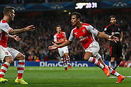Alexis Sanchez of Arsenal (right) celebrates scoring the opening goal against Besiktas J.K. during the UEFA Champions League match at the Emirates Stadium, London<br /> Picture by David Horn/Focus Images Ltd +44 7545 970036<br /> 27/08/2014