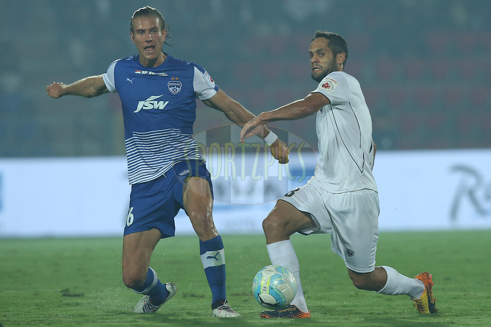 Erik Endel Paartalu of Bengaluru FC and Adilson Goiano of Northeast United FC in action during match 19 of the Hero Indian Super League between NorthEast United FC and Bengaluru FC held at the Indira Gandhi Athletic Stadium, Guwahati India on the 8th December 2017<br /> <br /> Photo by: Deepak Malik  / ISL / SPORTZPICS
