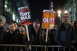 © Licensed to London News Pictures. 19/11/2019. Salford, UK. Protesters outside the event . Conservative Party leader Boris Johnson and Labour Party leader Jeremy Corbyn attend a televised election hustings at ITV Studios at Media City as part of their respective campaigns to win the upcoming general election and become the next British Prime Minister . Photo credit: Joel Goodman/LNP
