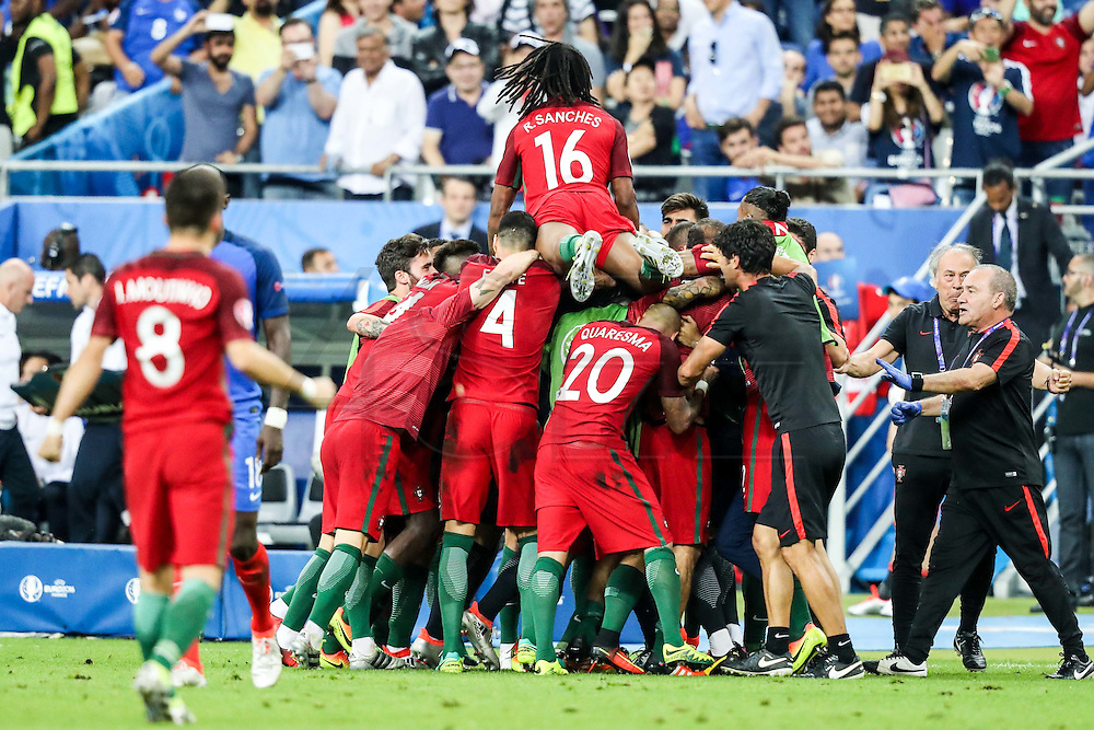 Portuguese players celebrating Ederzito's goal that made Portugal national squad become European Champions. Portugal beat home team France at Saint Denis stadium in Paris, after winning on extra-time by 1-0.