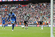 AFC Wimbledon striker Adebayo Akinfenwa (10) scores the penalty to make it 2-0 during the Sky Bet League 2 play off final match between AFC Wimbledon and Plymouth Argyle at Wembley Stadium, London, England on 30 May 2016.