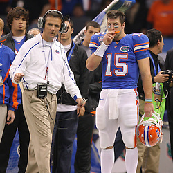 Jan 01, 2010; New Orleans, LA, USA;  Florida Gators head coach Urban Meyer with quarterback Tim Tebow (15) on the sideline during the first half against the Cincinnati Bearcats during the 2010 Sugar Bowl at the Louisiana Superdome.  Mandatory Credit: Derick E. Hingle-US PRESSWIRE.