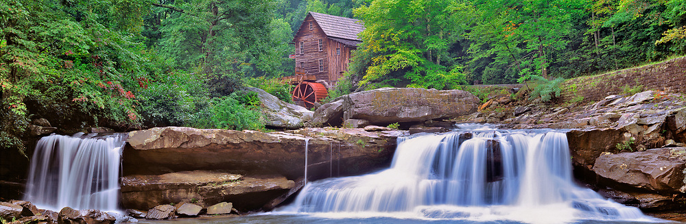 Two lovely waterfalls form the foreground Glade Creek Grist Mill, in Babcock State Park, West Virginia.