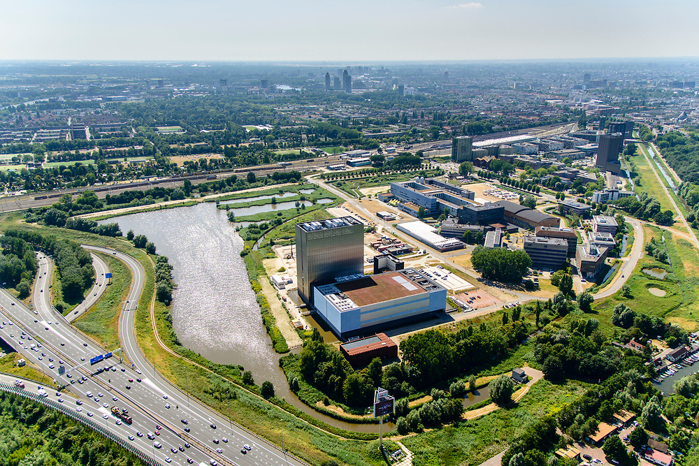 Nederland, Noord-Holland, Amsterdam,  29-06-2018; Watergraafsmeer, Science park met de hoogbouw van AM4 het nieuwste Equinix Data Centre. Hoogbouw Amstelstaion in de achtergrond.<br /> Science park with the high-rise of AM4 the latest Equinix Data Center.<br /> <br /> luchtfoto (toeslag op standard tarieven);<br /> aerial photo (additional fee required);<br /> copyright foto/photo Siebe Swart