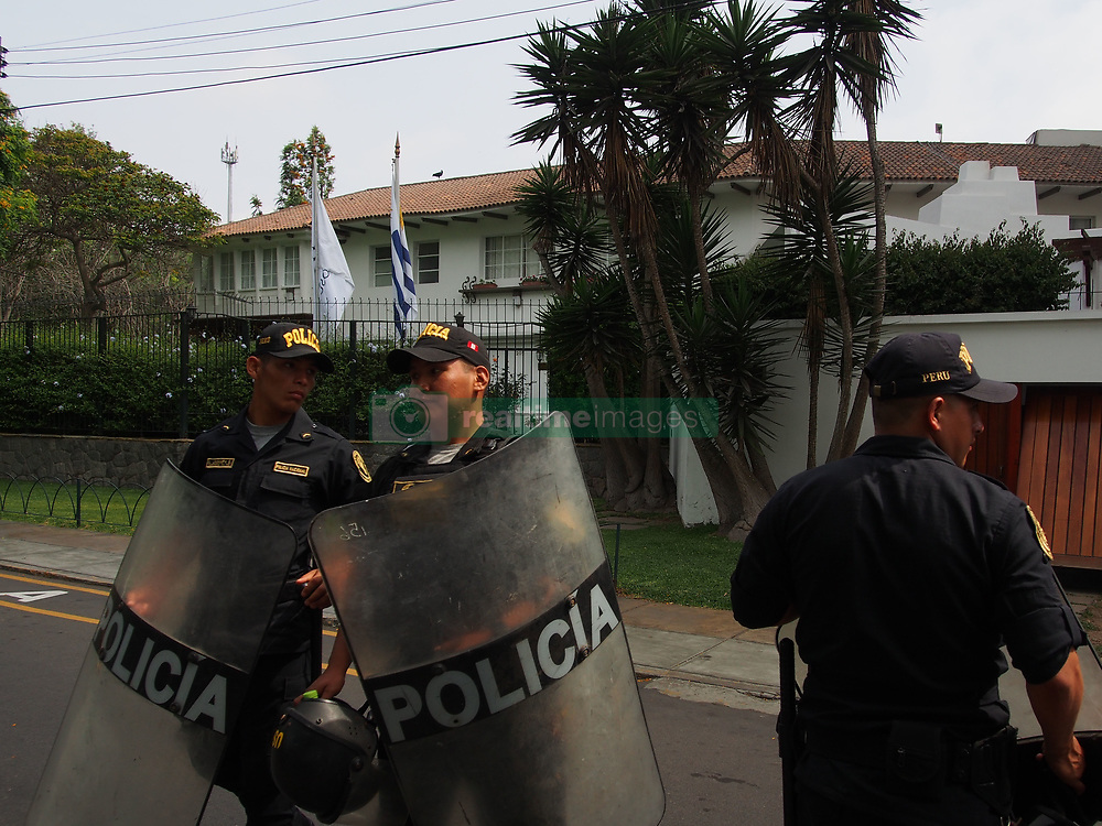 November 19, 2018 - Lima, Lima, Peru - Peruvian police watch the Uruguayan legation at 205 Pezet Av, in Lima, where former Peruvian President Alan Garcia Perez has taken refuge seeking political asylum. Garcia faces charges of corruption and money laundering related to the Odebrecht scandal. (Credit Image: © Carlos Garcia Granthon/ZUMA Wire)