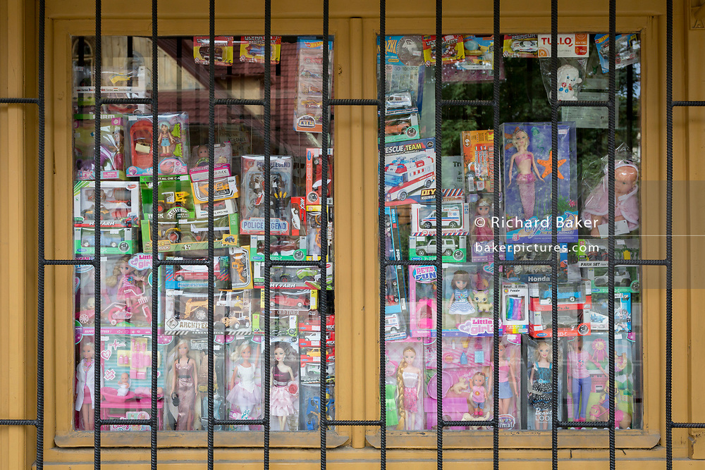 A detail of a Polish shop window selling assorted childrens' toys and girls' dolls, on 16th September 2019, in Zakopane, Malopolska, Poland.