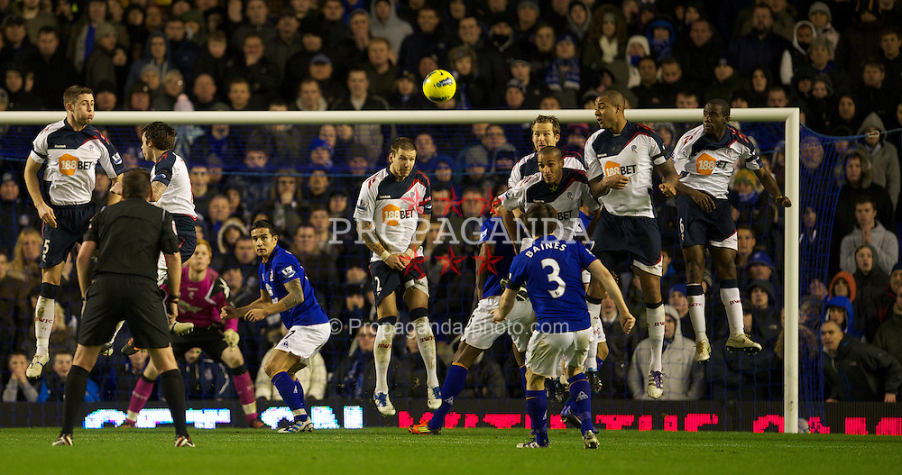 LIVERPOOL, ENGLAND - Wednesday, January 4, 2012: Everton's Leighton Baines takes a free-kick against Bolton Wanderers during the Premiership match at Goodison Park. (Pic by David Rawcliffe/Propaganda)