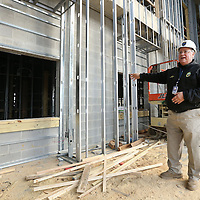 Adam Robison | BUY AT PHOTOS.DJOURNAL.COM<br /> Tupelo Police Chief Bart Aguirre, points out details and what will become of the entry way of the new police station that is being built on Front Street Tuesday afternoon in Tupelo.