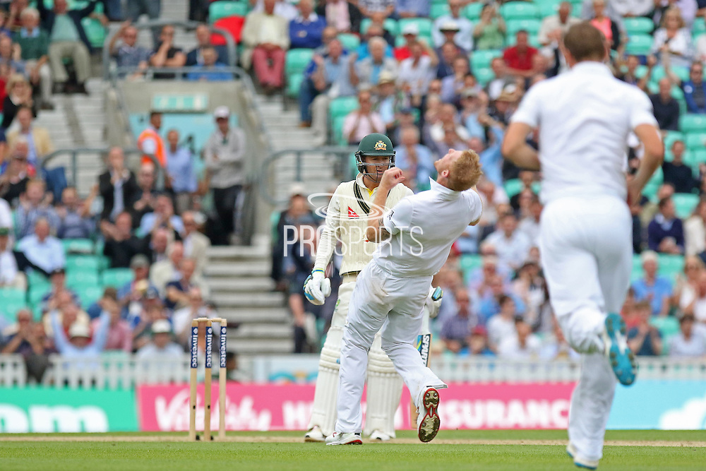 Michael Clarke captain of Australia awaits the umpires decision and Ben Stokes of England celebrates the wicket during the 1st day of the 5th Investec Ashes Test match between England and Australia at The Oval, London, United Kingdom on 20 August 2015. Photo by Phil Duncan.