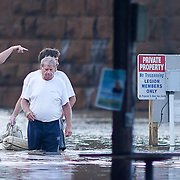 Boaters at American Legion post 47 walking in knee high water as Susquehanna river rises on Thursday, Sept. 08, 2011 in Havre De Grace, MD.<br /> <br /> Flooding from the remnants of Tropical Storm Lee drove hundreds of Maryland residents from their homes Thursday and claimed at least one life less than two weeks after Hurricane Irene soaked the national capital region. (AP Photo, Saquan Stimpson)