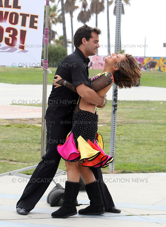 "VENICE, CALIFORNIA - FRIDAY 9TH MAY 2008. EXCLUSIVE: Dancing with the stars couple Cheryl Burke and Cristián de la Fuente film a segment for Dancing With The Stars at the Venice Beach Boardwalk. The dancers spent the afternoon walking around asking the public for votes. Cristián wore a sandwich board sign and held a mega phone and began shouting ""Free dance with Cheryl Burke in return for your vote! "".  Cheryl seemed somewhat embarrassed by this or maybe because there were no takers for the free dance! . The dancers left together in the same car with Cheryl driving .Photograph: On Location News. Sales: Eric Ford 1/818-613-3955 info@OnLocationNews.com"