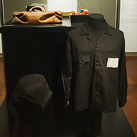 "TREVISO, ITALY - NOVEMBER 12:  A general view of some of the personal objects belonging to the last Emperor Pu Yi relating to his imprisonment,prison clothes, a royal seal, a bag, a cup and a plate with the inmates number, shown to the public for the very first time on November 12, 2011 in Treviso, Italy.  The exhibition called, ""Manchu, The Last Emperor"" will stay open until the 13th May 2012.  (Photo by Marco Secchi/Getty Images)"