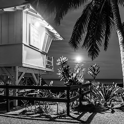 Kihei Maui Kamaole Beach lifeguard tower T2 at night black and white photo with the moon and pacific ocean. Copyright ⓒ 2019 Paul Velgos with All Rights Reserved.