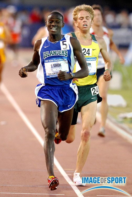 Shadrack Songok of Texas A&M-Corpus Christi celebrates after outkicking Galen Rupp of Oregon to win the 10,000 meters, 28:55.83 to 28:56.19, to become the Islanders first national champion in the NCAA Track & Field Championships at Sacramento State's Hornet Stadium in Sacramento, Calif. on Thursday, June 7, 2007.