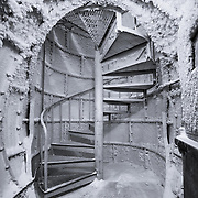 In the utility ice tunnels at South Pole is this spiral stair covered in ice crystals that leads up to the surface about 70 feet above. It's a strange site from above too, a tube with a door standing away from other structures out on the Ice.