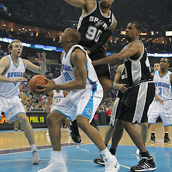 29 March 2009: New Orleans Hornets forward David West (30) is defended by San Antonio Spurs defenders Drew Gooden (90) and Kurt Thomas (40) during a 90-86 victory by the New Orleans Hornets over Southwestern Division rivals the San Antonio Spurs at the New Orleans Arena in New Orleans, Louisiana.