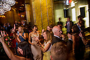 Photo by Matt Roth<br /> Assignment ID: 30148071A<br /> <br /> Wedding guests of Michael Widomski, a spokesman for the National Weather Service, right, and David Hagedorn, a chef and food writer, our of frame, join the couple on Fiola's dance floor in Washington, DC, Sunday, September 22, 2013.