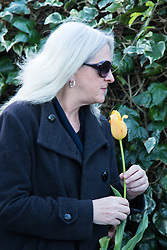 Highgate, London, December 26th 2016. Fans gather outside the London home of pop icon George Michael who died on Christmas day. PICTURED: A woman arrives with a single tulip.