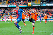 Mark Connolly (#55) of Dundee United FC clears the ball ahead of Jordan White (#19) of Inverness Caledonian Thistle FC during the William Hill Scottish Cup quarter final match between Dundee United and Inverness CT at Tannadice Park, Dundee, Scotland on 3 March 2019.