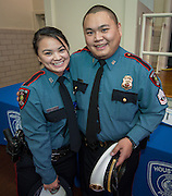 "Minhnguyet ""Nicky"" Tran, left, gets a hug from her brother Tridung Tran, right, following a swearing-in ceremony for new officers at the Houston ISD Police Department, March 3, 2014."