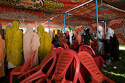 Ladies attending the first-ever international Conference on Womens' Challenge in Darfur, gather to dance and sing traditional songs in a compound belonging to the Govenor of North Darfur in Al Fasher (also spelled, Al-Fashir) where the women from remote parts of Sudan gathered to discuss peace and political issues.