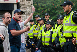 South Yorkshire PSU officers keep  UAF andi EDL members and supporters apart on a side street in Hexthorpe Doncaster South Yorkshire on Saturday Afternoon.<br /> The EDL and UAF are thought to have chosen Hexthorpe after recent media reports of tension between newly arrived Roma residents and the the local community<br /> 19 July 2014<br /> Image © Paul David Drabble <br /> www.pauldaviddrabble.co.uk