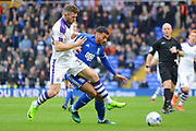 Birmingham City midfielder David Davis (26) and Newcastle United forward Daryl Murphy (33) battle for possession 0-0 during the EFL Sky Bet Championship match between Birmingham City and Newcastle United at St Andrews, Birmingham, England on 18 March 2017. Photo by Alan Franklin.