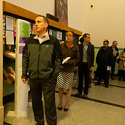 Voters queue in the West End, waiting for the polling station open at 7am. Scottish referendum in Edinburgh. All through out the day a huge number of voters turned out asll over Scotland to vote in the independence referendum. The polls were open from 7am till 10pm and the count went on through-out the night with the final results announced early in the following morning.