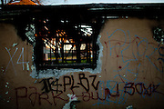 An abandoned home is burned and covered in gang tags in the Parklawn neighborhood in Modesto, Calif., February 23, 2012.