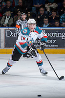 KELOWNA, CANADA - JANUARY 24: Cody Fowlie #18 of the Kelowna Rockets skates after the puck against the  Seattle Thunderbirds at the Kelowna Rockets on January 24, 2013 at Prospera Place in Kelowna, British Columbia, Canada (Photo by Marissa Baecker/Shoot the Breeze) *** Local Caption ***