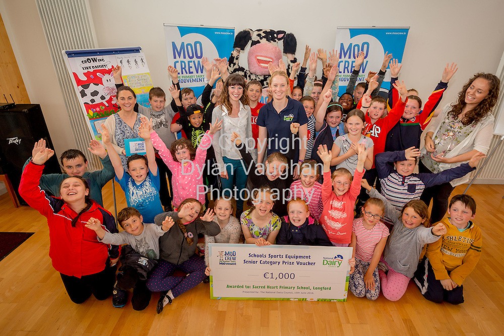 Repro Free no charge for Repro<br /> <br /> 15-6-16<br /> <br /> DERVAL O&rsquo;ROURKE CELEBRATES WITH WINNING MOO CREW SCHOOLS FROM DONEGAL &amp; LONGFORD<br />  <br /> Derval O&rsquo;Rourke, the well-known sprint hurdler who is a World Indoor Champion, multiple European medallist and three time Olympian, was in Dublin today (15th June, 2016) to celebrate with the top winning primary school children in the National Dairy Council&rsquo;s Moo Crew &ndash; Primary Dairy Moovement.<br /> Moo Crew is a fun and interactive way for children to learn about the benefits of a healthy, balanced diet and the importance of exercise &ndash; to &lsquo;get moo-ving&rsquo;.  It is supported by the NDC in light of research that showed 37% of girls and 28% of boys aged from 5 &ndash; 12 years in Ireland had inadequate calcium intakes in their diet.<br />  <br /> The top classes in the Junior Category and Senior Category of the NDC&rsquo;s national competition each won a sports equipment pack worth &euro;1,000 for their school and the day out in Airfield Farm in Dublin, with Olympic star Derval O&rsquo;Rourke.  The overall national winners of Moo Crew for 2016 are:<br /> &middot;         National Winners, Junior Category - Junior Class, Little Angels Special School, Letterkenny, Co. Donegal (Junior class Teacher Mr. Daire Diver)<br /> &middot;         National Winners, Senior Category - 4th &amp; 5th Class, Sacred Heart Primary School, Granard, Co Longford (Teachers Ms. Carmel Shaughnessy and Ms. Grace McGauran)<br /> <br /> Milly, the Moo Crew Mascot cow, joined in the action packed day which included milking cows, farmyard experiences and butter making; as well as activities such as bug hunting and woodland walks.  Further details and information about county winners at www.ndc.ie.<br />  <br /> Pictured at Airfield Farm were National Winners, Senior Category - 4th &amp; 5th Class, Sacred Heart Primary School, Granard, Co Longford with Caroline O&rsquo;Donovan, Nutritionist, National Dairy Council; Derval O&rsquo;Rourke; Milly, the Moo Crew Mascot cow and teachers Grace McGauran and Carmel Shaughnessy McKeon.<br /> Picture Dylan Vaughan