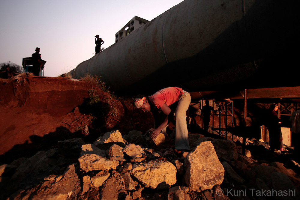 Workers repair base of a water pipeline in Bhandup, Mumbai, India on March 27, 2010 after it was bursted due to decrepitation. Due to the lack of rain during last year's monsoon, Mumbai is facing one of the worst water shortage in its history and the Municipal Corporation of Greater Mumbai (BMC) has cut 15 % of its water supply in March. Poor maintenance of the pipeline and water thieves, who connect illegal pipes to the city's water line and steal water for sale, are blamed for a part of the shortage.Photo by Kuni Takahashi