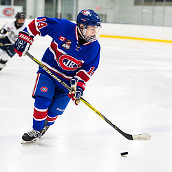 TORONTO, ON  - OCT 29,  2017: Ontario Junior Hockey League game between the Toronto Jr. Canadiens and the Toronto Patriots, Mathew Rehding #14 of the Toronto Jr. Canadiens skates with the puck. <br /> (Photo by Catherine Kim / OJHL Images)