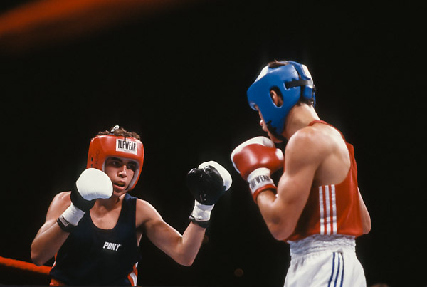 SEATTLE - AUGUST 2:  Oscar De La Hoya (USA)(red headgear) boxes Airat Khamatov (URS) (blue headgear) during the semi finals of the 57 kg (125 lb) class of the 1990 Goodwill Games on August 2, 1990 at the Seattle Center Coliseum in Seattle, Washington. De La Hoya was the gold medalist in the event.  (Photo by David Madison/Getty Images) *** Local Caption *** Oscar De La Hoya