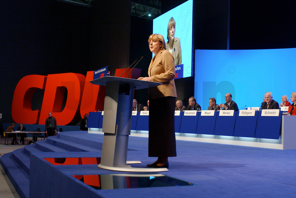 11 NOV 2002, HANNOVER/GERMANY:<br /> Angela Merkel, CDU Bundesvorsitzende, waehrend ihrer Rede, CDU Bundesparteitag, Hannover Messe<br /> IMAGE: 20021111-01-036<br /> KEYWORDS: Parteitag, party congress, speech, Logo, sign