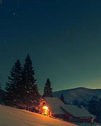 Benkovsi hut in Balkan Mountain in winter time  at night