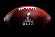 An official game ball for the NFL football Super Bowl XLIX is seen Tuesday, Jan. 20, 2015. The Wilson Sporting Goods football factory in Ada, Ohio, which has made the official Super Bowl football since the first Super Bowl in 1966, began making the this year's game balls Sunday night immediately after the conclusion of the NFC and AFC championship games. The New England Patriots will play the Seattle Seahawks in the Super Bowl on Feb. 1 in Glendale, Arizona. (AP Photo/Rick Osentoski)
